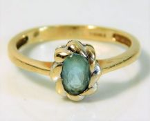 A 9ct gold ring set with topaz 2g size N