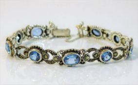 A silver bracelet set with marcasite & blue stone