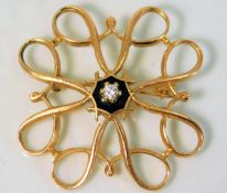 A 9ct gold brooch set with small diamond 2.5g