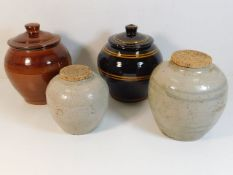 Two Oriental stoneware ginger jars with later cove
