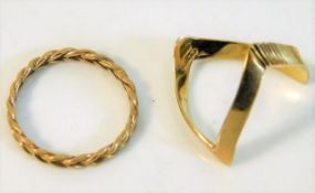 A 9ct gold wishbone ring size N/O twinned with one