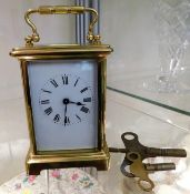 A French brass carriage clock with keys