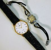 A ladies Tudor wrist watch twinned with a quartz O