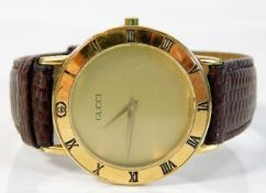 A gents gold plated Gucci 3000 2m wrist watch, som