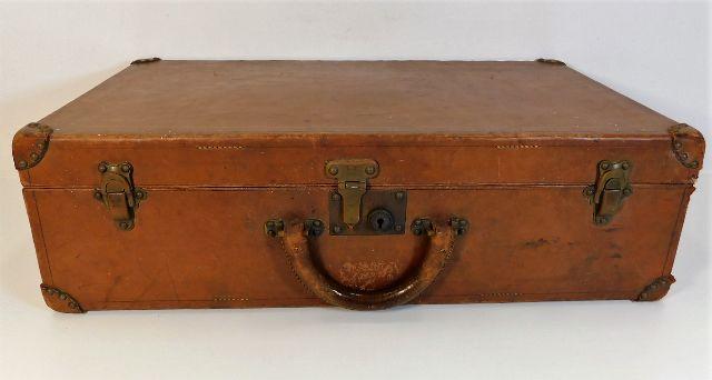 Lot 111 - An antique Louis Vuitton leather suitcase