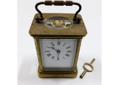 A brass carriage clock with key 5.5in tall inc. ha