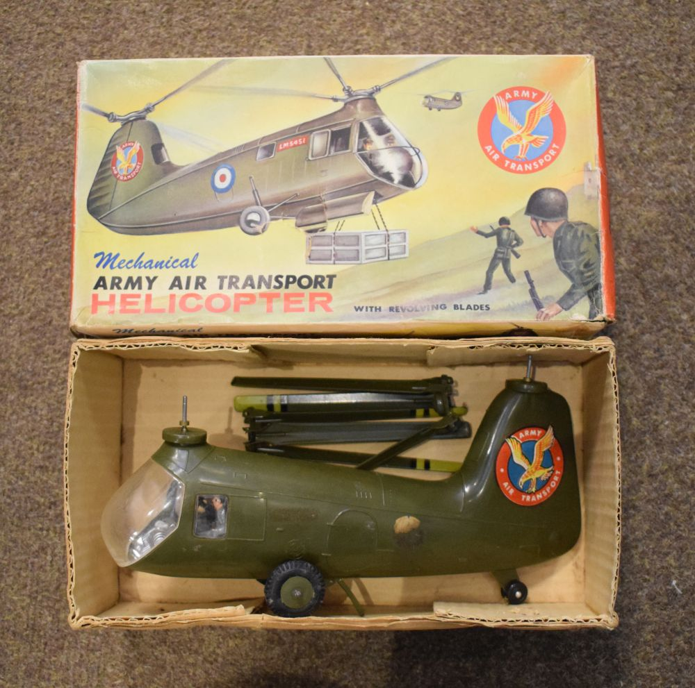 Lot 355 - Marx Toys made mechanical army air transport helicopter with revolving blades, within original box