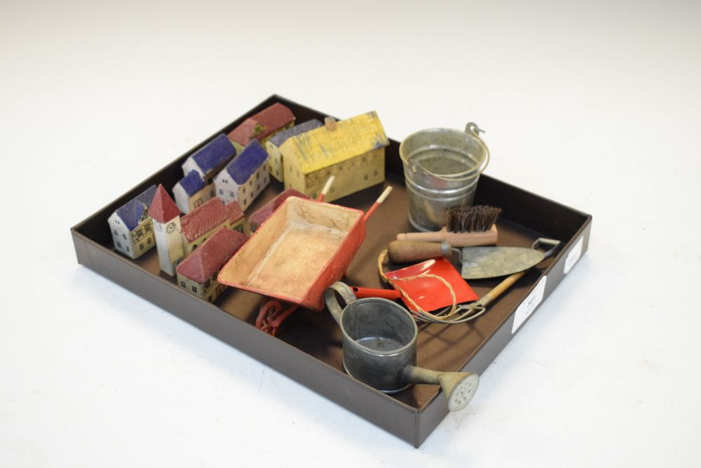Quantity of small painted wooden buildings, together with tin bucket, trowel etc