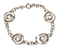Jane Watling 'Montana Swirl' silver bracelet, London 1991, 20cm long Condition: **General