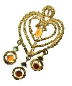 Citrine and green tourmaline heart shaped pendant brooch, tagged '750', 5cm long, 11g gross