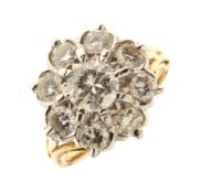Nine stone diamond cluster ring, the yellow mount stamped '18', the centre stone calculated as
