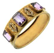 Late 19th Century hinged bangle, unmarked gold, the three rectangular cut stones with seed pearl set