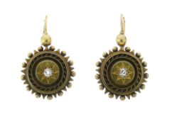 Pair of Victorian unmarked gold diamond set earrings, the circular panel set with a small old