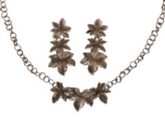Jane Watling silver necklace with ivy leaf frontispiece; with a pair of matching drop earrings,