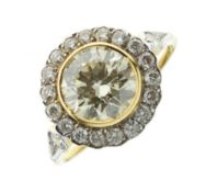 Diamond cluster ring, the yellow mount indistinctly marked, the central fancy light yellow brilliant