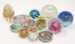 A collection of glass paperweights to include Caithness millefori and imperial.