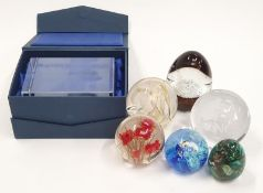A collection of paperweights to include the Caithness outlets Elliotts stone from Israel and the