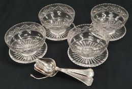 4 glass grapefruit dishes and a set of grapefruit spoons.