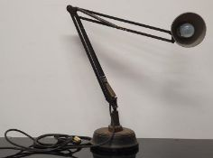 An antique industrial Anglepoise style lamp with solid base.