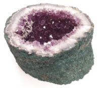 A large Amethyst crystal.