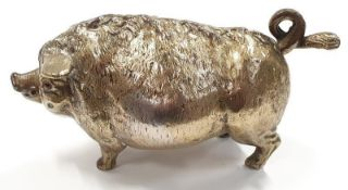 A vintage solid brass wind up bell in the form of a pig.