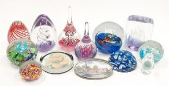 A collection of paperweights to include millefiori Murano castelino.