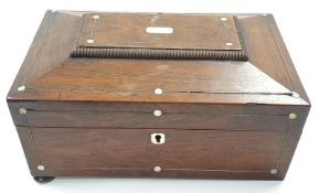 A vintage mahogany jewellery box with mother of pearl inlay to lid.