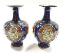 A pair of Royal Doulton Lambeth stoneware posy vases 8384.