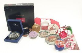 A collection of paperweights to include Caithness Swarovski and Wedgwood.