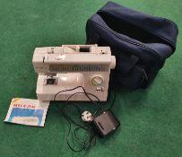 Riccar electric sewing machine in storage bag (WP114).