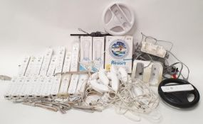 Box of mainly Nintendo Wii controllers and leads (WP36).