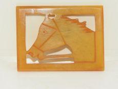 Art Deco amber bakelite/catalin race horse brooch.