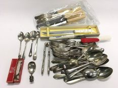 Quantity of silver plated and silver flatware to include a caddy spoon.