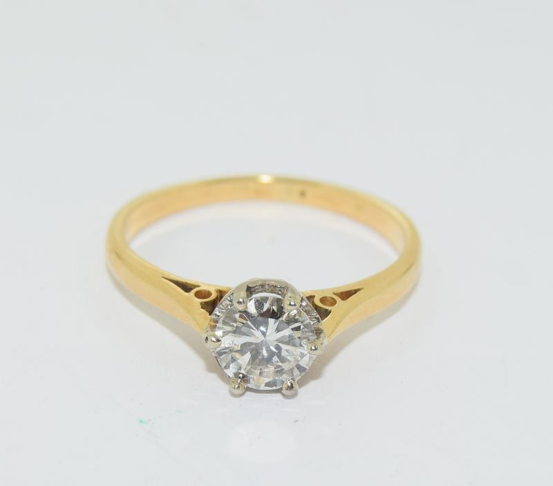 18ct Gold ladies Diamond Solitaire ring. Size N.