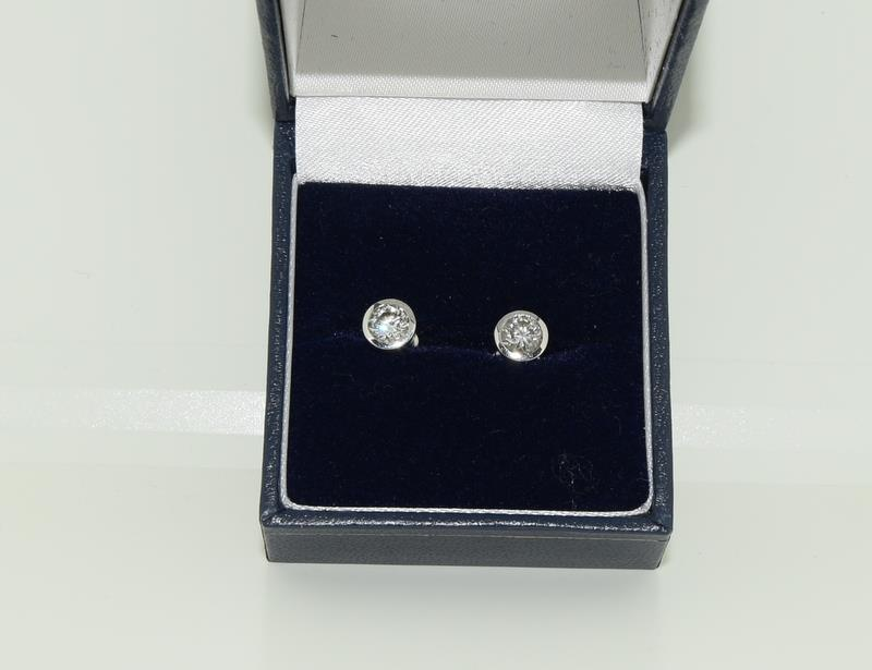 A pair of approx. 1 carat Diamond Solitaire studs in 18ct white gold.