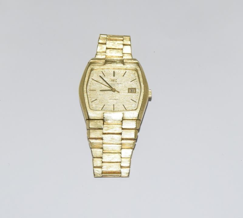 Gents 18ct gold IWC automatic wristwatch bark effect bracelet with gold dial,working order ,total