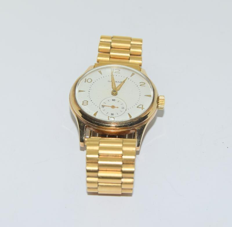 Garrard 9ct Gold 1960s presented by the Ford Motor Company gents manual wind wrist watch.