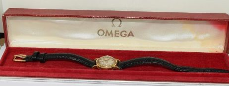 18ct Gold ladies Omega manual wind wrist watch, boxed.