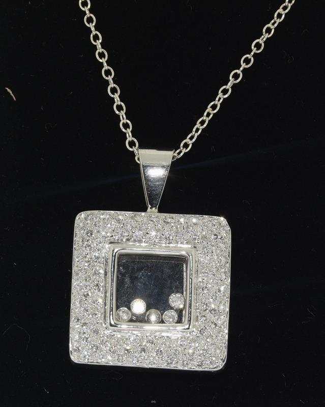 A 14ct white gold diamond Geometric glazed panel pendant.
