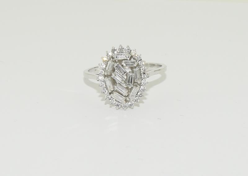 An 18ct white gold and Diamond Fancy Baguette and round cut abstract cluster ring, Size Q 1/2. - Image 5 of 5