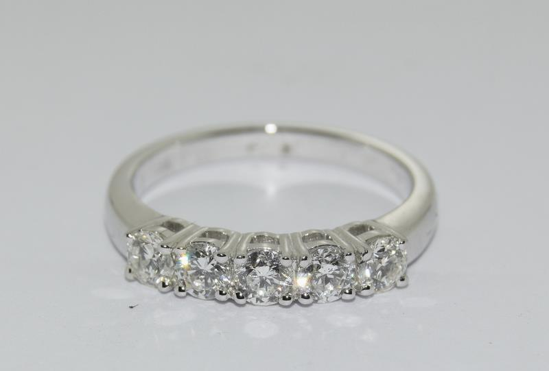 An 18ct white gold five stone diamond ring of 1.2cts. Size M