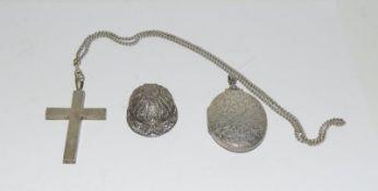 Silver locket, cross and filigree jockey helmet. 55 grams.