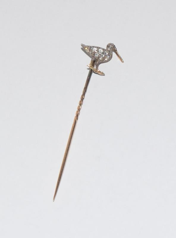 Antique gold and old cut diamond stick pin in the form of a Curlew bird