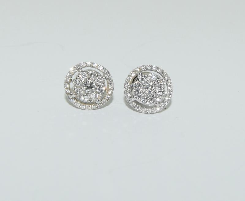 A pair of 0.66 carat diamond 18ct white gold Halo stud Earrings. - Image 2 of 5