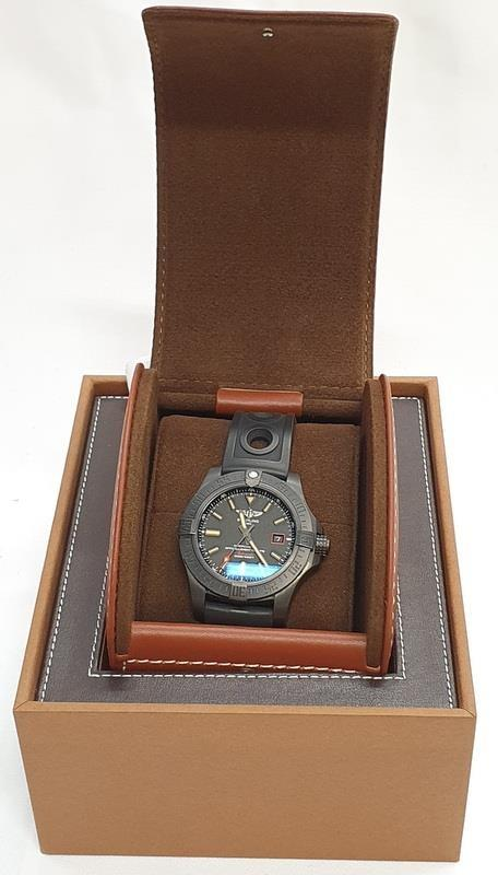 Breitling Blackbird Watch in box with papers.