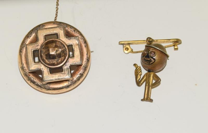 Victorian yellow metal brooch and a brooch in the shape of a school boy.