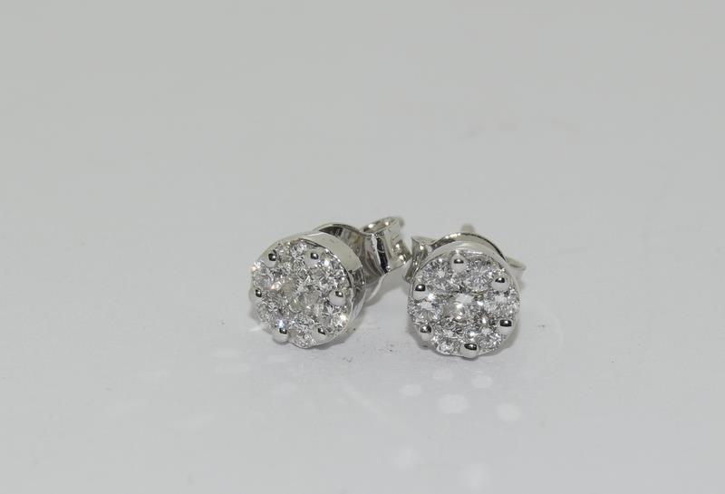 A pair of 18ct white gold stud earrings of 50 points. - Image 2 of 3