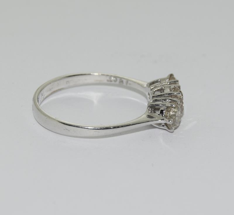 An 18ct white gold three stone diamond ring of 1.1cts. - Image 2 of 4