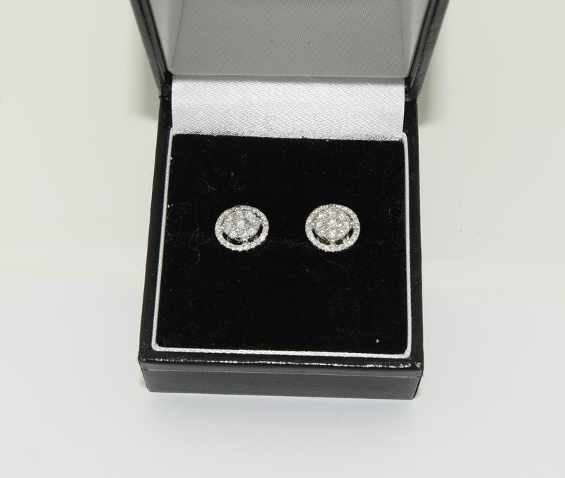 A pair of 0.66 carat diamond 18ct white gold Halo stud Earrings.