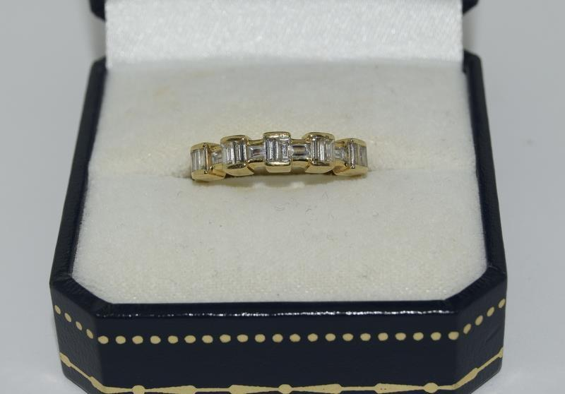 Baguette set Diamond ring - approx 0.75 points total, set in heavy 18ct Yellow Gold. Size O, Boxed.